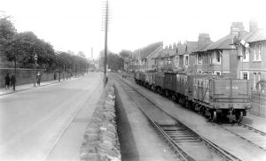 1. Cardiff Rd Sidings 1930 The railway storage sidings on Cardiff Road outside the Royal Gwent Hospital in the summer of 1930. Officially known as 'Pitwood Sidings', the lines originally formed part of the early tramroad route along Cardiff Road to the wharves on the River Usk via George Street and Kingsway. From 1852 this route through the streets of Newport was developed by the Monmouthshire Railway & Canal Company into a passenger service from the Western Valleys that headed through Salutation Junction and George Street, terminating at Dock Street Station. Through running of rail traffic from Courtybella Junction ceased in 1907, and all traffic used the alternative route via the 'Neutral Mile' section through Pillgwenlly. Although out of use from 1907 the GWR maintained its right of way along the original route until the 1920's by the annual passage of a locomotive running light on Good Fridays. Newport Reference Library
