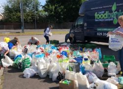 Bags laid out alongside a foodbank truck